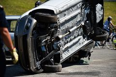 Scene of a car crash and emergency rescue service. In action stock images