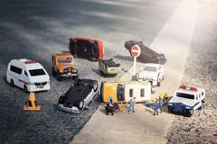 Scene of cars miniature, toy model accident on street.