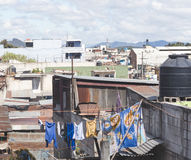 Scene from a city in Guatemala, Central America. Shacks, buildings, and clothes on a clothes line in Guatemala Royalty Free Stock Images