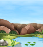 Scene of cliff and pond Royalty Free Stock Photo