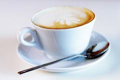 Cup of coffee with milk and cream Stock Images