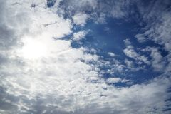 Scene of dense free form white cloud as per imagination on bright blue sky background Stock Photos