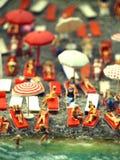 Scene di modello miniatura della spiaggia ammucchiata Immagini Stock Libere da Diritti