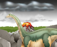 Scene with dinosaur and volcano Royalty Free Stock Images