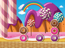 Scene with donuts and lollipops by the beach Royalty Free Stock Images