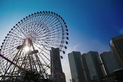 Scene of a Ferris wheel and the high-rise building. Scene of the day when it was fine of a Ferris wheel and the high-rise building of Japanese Yokohama -city Royalty Free Stock Photos