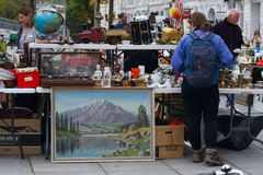 Scene from Flea market where people sell and buy used toys, clothes, pictures, kitchen ware and other vintage things