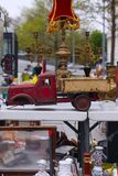 Scene from Flea market where people sell and buy used toys, clothes, pictures, kitchen ware and other vintage things royalty free stock image