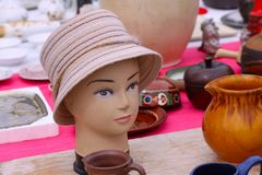 Scene from Flea market where people sell and buy used toys, clothes, pictures, kitchen ware and other vintage things. Scene from Flea market where people sell Royalty Free Stock Image