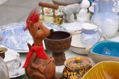 Scene from Flea market where people sell and buy used toys, clothes, pictures, kitchen ware and other vintage things. Scene from Flea market where people sell Royalty Free Stock Photo