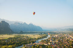 Scene of flying hot air balloon over city Royalty Free Stock Photography