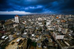 Gaza City in a day filled with clouds of rising. A scene of Gaza City in a day filled with clouds of rising stock photography