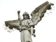 Scene in a graveyard: old statue of an angel with broken wings. stock image