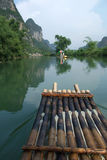 Scene of Guilin, China. A boat along water of Guilin China, surrounded by grotesque mountains royalty free stock images
