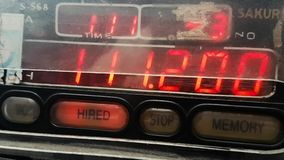 Misc taxi meter. Scene from Hanoi Vietnam Asia slow close motion up of taxi meter running large fare stock video footage