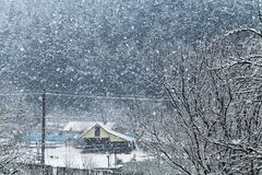 Scene of heavy snowing in the village. Romania Royalty Free Stock Images