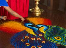 Scene in hindu temple. Creating bright picture on a floor. Scene in hindu temple in Kuala Lumpur. Artist creating bright picture on a floor royalty free stock photography