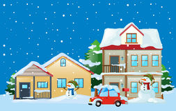 Scene with houses and snowman in winter Stock Photography