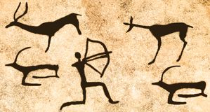 A scene of hunting on the wall of the cave. Stock Image