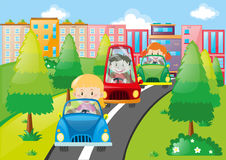 Scene with kids driving cars in city Stock Photo