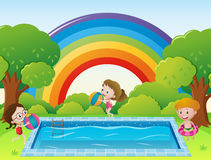 Scene with kids in the swimming ppol Royalty Free Stock Image
