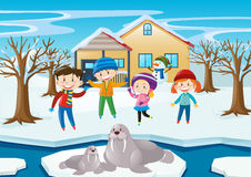 Scene with kids and walrus in winter Stock Photo