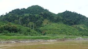 Laos Countryside. Scene from Mekong River Laos South East Asia Slow View Motion from boat Countryside rolling hills trees mountains rural stock video