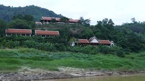 Laos Pak Beng. Scene from Mekong River Laos South East Asia slow view motion from boat countryside rolling hills trees mountains rural stock video