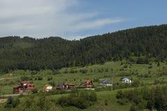 Scene with mountain top, valley and residential district of bulgarian village Beli Iskar, Rila mountain. Bulgaria Royalty Free Stock Image