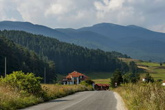 Scene with mountain top, valley and residential district of bulgarian village, Rila mountain. Bulgaria Stock Photography