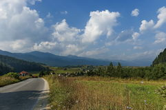 Scene with mountain top, valley and residential district of bulgarian village, Rila mountain Stock Images