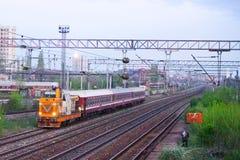 Scene of orange locomotive and red train in Carpati station, Bucharest, CFR Royalty Free Stock Photo