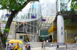 Scene outside Orchard Central Mall 2. These people are enjoying their time at a mall along Orchard road in Singapore while food vendors make a sale Stock Images