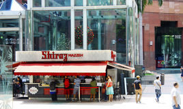 Scene outside The Orchard Central Mall. After shopping, eat at Shirraz fastfood vendor outside   for just 10 Singapore dollars you have a stomach full of kebabs Stock Photo