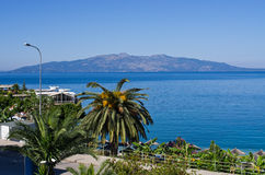 Scene with palm and see in Saranda, Albania Royalty Free Stock Photo