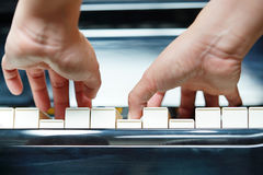 Scene of pianist hands from underneath. Royalty Free Stock Image