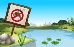 Scene with pond and sign no mosquitoes Royalty Free Stock Image
