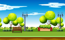 Scene of public park with bench and lamps Royalty Free Stock Photo