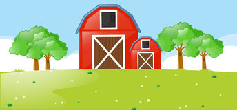 Scene with red barns in the field Stock Photo