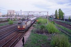 Scene of red locomotive and red train in Carpati station, Bucharest, CFR Stock Photos