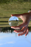 Scene reflection beyond glass sphere. Close up Royalty Free Stock Photos