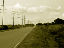 Scene from the Road. A sepia toned perspective view of the road ahead Royalty Free Stock Images