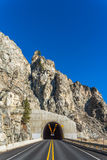 Scene of Road Tunnel - Mountain Tunnel on sunny day  with blue sky background.. Stock Photo