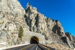 Scene of Road Tunnel - Mountain Tunnel on sunny day  with blue sky background.. Stock Images