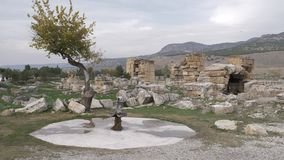 Ancient drinking fountain and ruins of Hierapolis in Pamukkale, Turkey stock video footage
