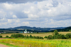 Scene of rural settlement and church in Siberia, Russia Royalty Free Stock Image
