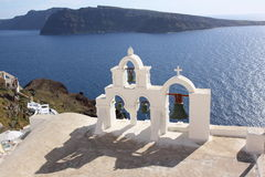 Scene in Santorini in Greece. Scene with white and blue house and buildings,  and church in Santorini island in Greece in May. blue sky and white cloud Stock Images