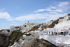 Scene in Santorini in Greece. Scene with white and blue house and buildings, sea and church in Santorini island in Greece in May. blue sky and white cloud Royalty Free Stock Image