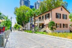 Scene of the Sarona compound, in Tel-Aviv. TEL-AVIV, ISRAEL - MAY 18, 2017: Scene of the Sarona compound, with visitors, in Tel-Aviv, Israel. It was established Royalty Free Stock Image