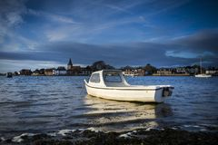 Boat catching golden sunlight at Bosham in Sussex Royalty Free Stock Image